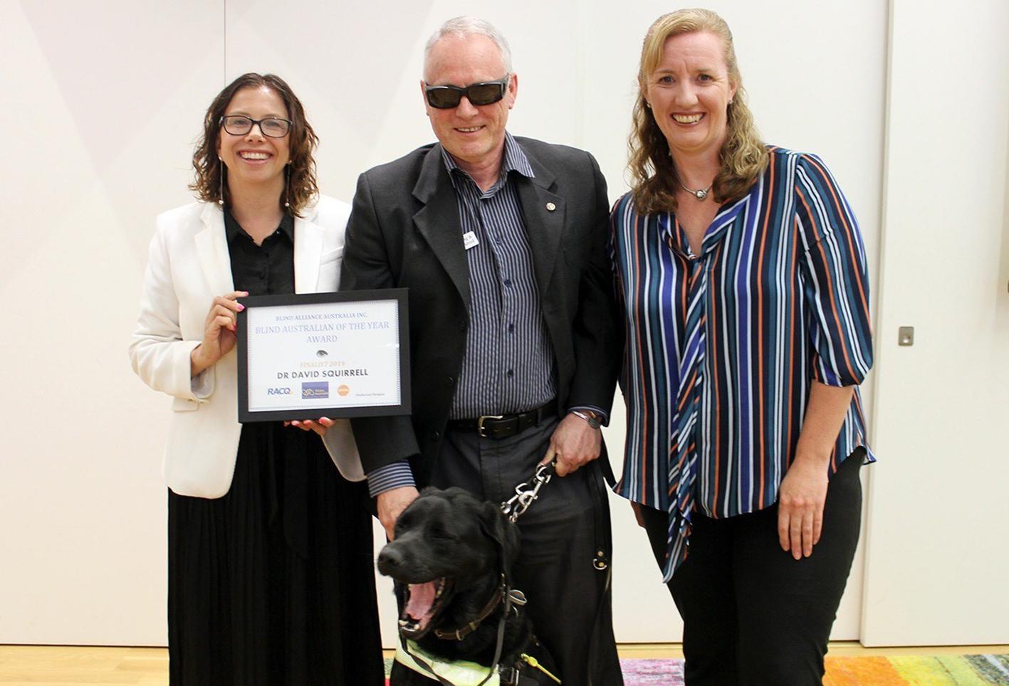Amanda Rishworth presents an award for Australian Blind Person of the Year