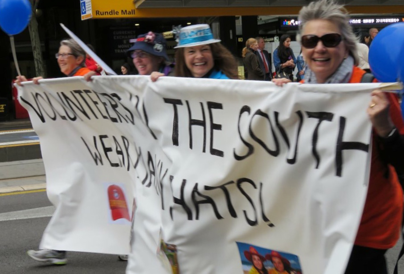 Southern Adelaide volunteers march in a parade
