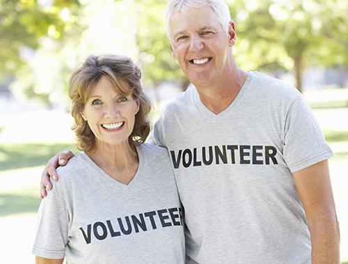 Senior Couple Working As Part Of Volunteer Group
